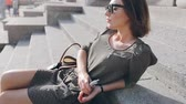 cigarro : beautiful brunette smoke electronic cigarette in public places