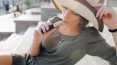 fumante : beautiful brunette smoke electronic cigarette in public places