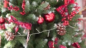 коробка подарка : Close-up of a beautifully dressed Christmas tree. She is stylishly decorated. The camera goes slowly from top to bottom. Lanterns are burning on the Christmas tree. New year, miracles, magic