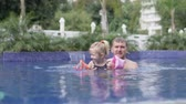 Dad teaches to swim little daughter. The man lets the baby swim alone in the sleeves Стоковые видеозаписи