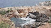 kıbrıs : Beautiful view of Cape Greco in Cyprus. The waves beat on the rocks, the grass sways in the wind. Beautiful nature untouched by man Stok Video
