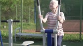 tornacipő : The boy goes in for sports on a street simulator in the summer in the park.