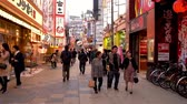kansai : OSAKA, JAPAN - APRIL 11, 2018: the fast motion of visitors and tourists walking in the tsutenkaku shopping and food street in daytime.