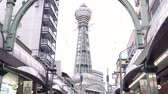 kansai : OSAKA, JAPAN - APRIL 11, 2018: the upward view of shinsekai tsutenkaku tower with a white sky in fast motion. Stock Footage
