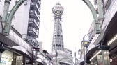 kansai : OSAKA, JAPAN - APRIL 11, 2018: the upward view of shinsekai tsutenkaku tower with a white sky.
