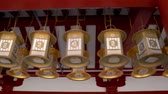 kansai : OSAKA, JAPAN - APRIL 13, 2018: movement of camera for the detail of golden decorative lanterns in the temple.