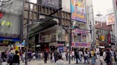 dotonbori : Osaka, Japan-April 14, 2018: many tourists crossing the road and visiting the famous shopping street Shinsaibashi