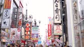 dotonbori : Osaka, Japan-April 14, 2018: the street is full of colorful sign boards of restaurants, cloth shop, and pharmacies