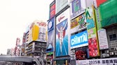 nippon : Osaka, Japan-April 14, 2018: billboard wall is full of advertisements with cute cartoon characters