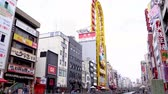 dotonbori : Osaka, Japan-April 14, 2018: Japanese lifestyle in Osaka, traditional street food with big sign outside the store and many tourists taking pictures in the lively city