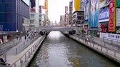 dotonbori : Osaka, Japan-April 14, 2018: city sight with a quiet clean river located in a busy area in Japan