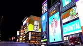 city lifestyle : Osaka, Japan-April 15, 2018: lots of billboards hanging on the wall of the building at a dark night