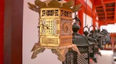 faroles : NARA, JAPAN - APRIL 16, 2018: many golden and metal lanterns hanging in the  Kasuga Grand Shrine