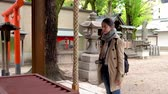 classic architecture : fast motion of female tourist experience Japanese traditional religion in the temple Stock Footage
