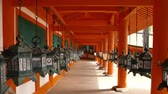 chodba : corridor hanging with many metal lanterns in the Japanese temple