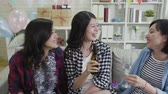 pískat : Group of asian girl friends toasting wine glasses and having fun indoors. young ladies raising hands high cheers champagne and beer celebrating holiday event. friendship lifestyle chilling concept.