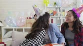 благодарность : slow motion of happy birthday girl receiving presents and hugging thankful friend with love. decorated cozy living room with colorful gift boxes and balloons. young ladies laughing in house party. Стоковые видеозаписи