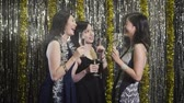 wine : slow motion clubbing girls cheers wine and chatting cheerfully. Sexy Asian female models night lifestyle at club. group of fashion women holding glasses of champagne touching together. Stock Footage