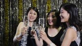 toasting : slow motion of ecstatic friends with champagne talking at party in nightclub. Clubbing concept for nightlife. Young friendly people toasting in disco club.