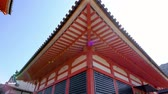 kansai : 1200 years old Buddhist temple of Kiyomizu dera in kyoto japan. red wooden roof in japanese building traditional style of pagoda. beautiful amazing design with windows of shinto under blue clean sky.