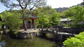 quioto : Traditional pond at  Kiyomizu dera temple kyoto japan. ancient oldest Buddhist temple located in nature surrounding by spring trees and plants on sunny day. green clean water in small lake outdoors