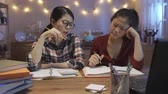 request : group of students studying indoors at home on wooden table. Stock Footage