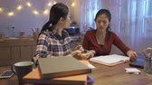 dormitory : Two angry female students arguing doing homework at home. group of college girls having bad teamwork shouting screaming each other with textbook. roommate unsatisfied report project in kitchen night. Stock Footage