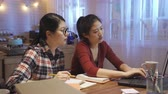 dormitory : group of college girls preparing for seminar at night in home kitchen.