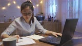 dormitory : young lady worker freelance typing on keyboard, accounting finances. Stock Footage