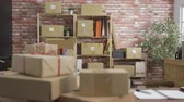 karton : Internet shopping online purchases e-commerce and package delivery concept. cardboard boxes on desk table in modern interior small startup business workplace. empty office no people red brick wall Stok Video