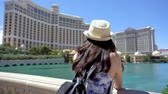 woman traveler leaning on railing outdoor watching beautiful fountain. Stock Footage