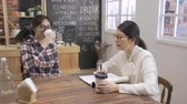 Friendly asian hr woman listening to candidate and talking at job interview in cafe bar. Stock Footage