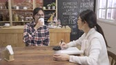 elegant female businesswoman interviewing female applicant in cafe bar in day time. Vidéos Libres De Droits