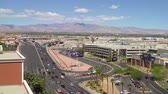 LAS VEGAS, USA - MAY 28, 2018 : roads of Las Vegas cityscape in morning after sunrise. cars driving fast on highway in nevada us. beautiful urban view with clear sunny blue sky on summer season. Stok Video