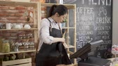 waitress wearing apron at cafe counter in the early morning after open shop.