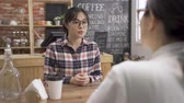 samenvatting : back view of business woman interviewing new asian female applicant candidate for marketing team staff in cafe bar.