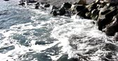 거품 : Foaming and splashing background of sea waves near a rocky shore in sunny weather 무비클립