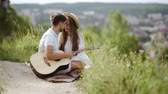paixão : Love. Romantic Couple Having Fun Outdoors. Loving People Spending Time Together On Summer Vacation In Nature. Beautiful Happy People With Guitar Smiling And Enjoying Each Other. Relationship. Vídeos
