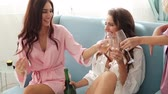 roucho : Girls Party. Beautiful Women Friends In Robes Having Fun At Bachelorette Party. Gorgeous Smiling Female Models In Silk Pink Pajamas Celebrating And Drinking Champagne At Hen Party.