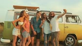 carro : Friends Taking Photo On Phone In Nature In Summer. Happy Young Men And Beautiful Women Enjoying Summer Travel On Vacation, Spending Leisure Time Together Near Retro Bus Outdoors. Vídeos