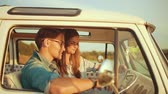 путешествие : Couple Travel With Map In Car In Summer. Happy Smiling Young People Using Map, Traveling On Summer Vacations. Handsome Man And Beautiful Woman Having Trip. Стоковые видеозаписи