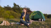 namiot : Happy Woman Traveling On Weekend, Sitting Near Camping With Beer And Playing With Dog In Nature