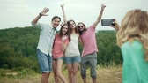fotky : Happy Friends Taking Photos On Phone In Nature, Having Fun And Laughing On Weekend Outdoors. Dostupné videozáznamy