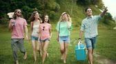 sarılma : Happy Friends Having Fun Outdoors In Nature. Men And Women Laughing While Walking In Park.