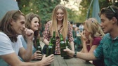 cheer : Friends Drinking Beer And Toasting, Enjoying Weekend At Outdoor Party In Summer.