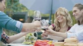 мужской : People Cheering With Drinks Wine Enjoying Outdoor Dinner Party