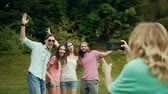 fotografie : Happy Friends Taking Photos On Phone In Nature.