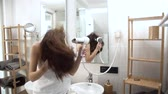 rotina : Hair Care. Woman Drying Long Hair With Hairdryer At Bathroom