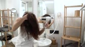 cal : Hair Care. Woman Drying Long Hair With Hairdryer At Bathroom