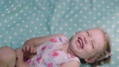 śmieszne : Happy Child Lying And Laughing From Tickling Closeup